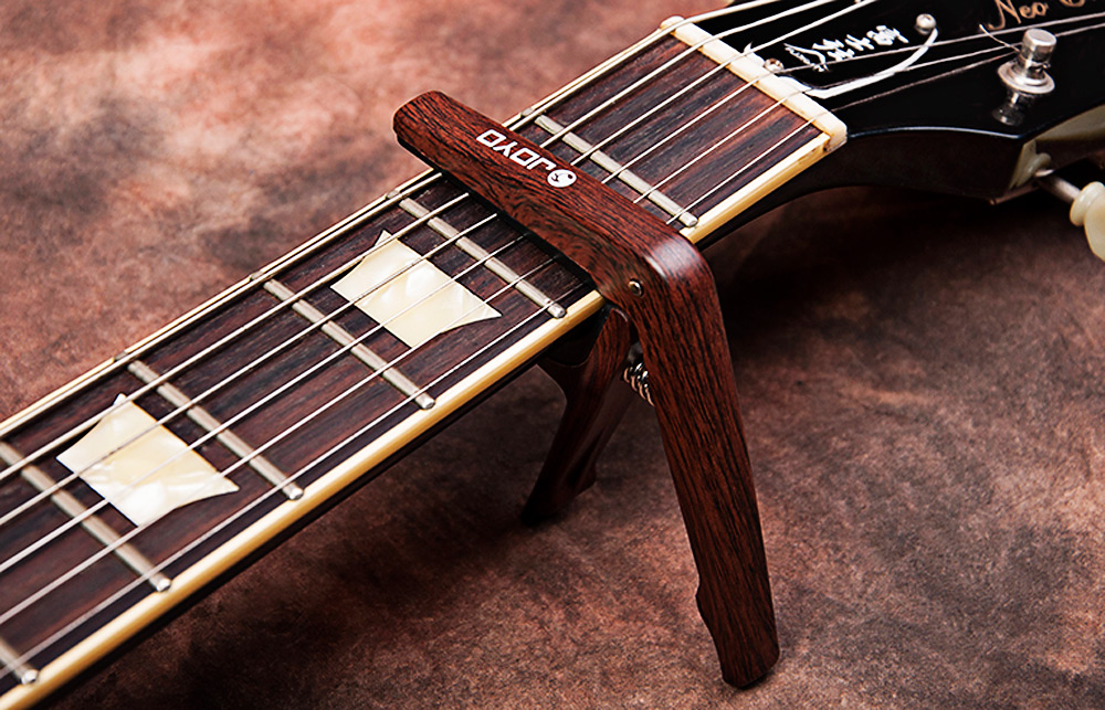 JOYO JCP - 01 Light Professional Capo with Pick for String Acoustic Electric Guitar