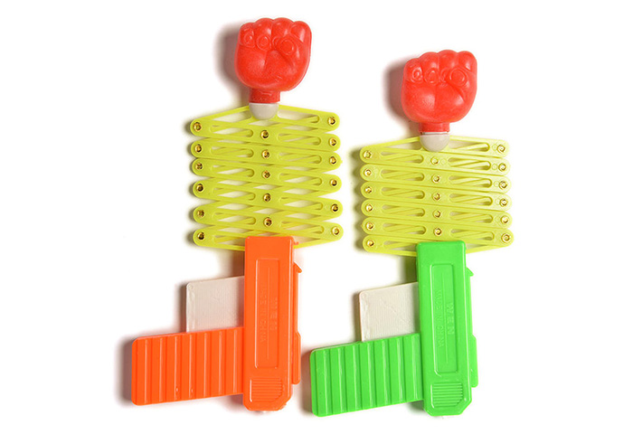 1PC Funny Elastic Fist Gun Shape Shooter Tricky Toy Gift for Child Kid